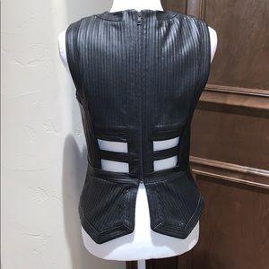 BCBGMaxAzria Tops - BCBG Maxazria faux leather top